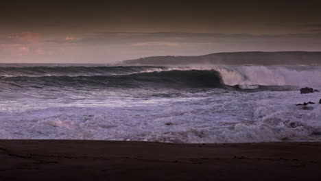 Big-waves-roll-into-a-beach-following-a-big-storm-in-slow-motion-2