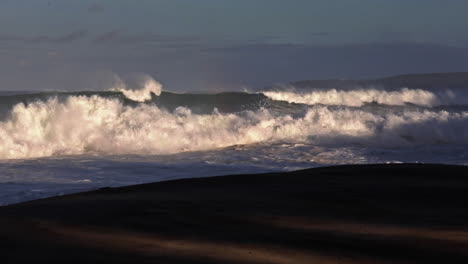 Waves-roll-into-a-beach-following-a-big-storm-in-slow-motion-5