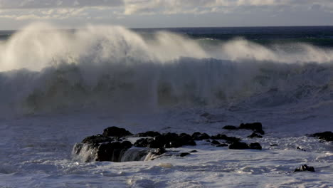 Windswept-waves-roll-into-a-beach-following-a-big-storm