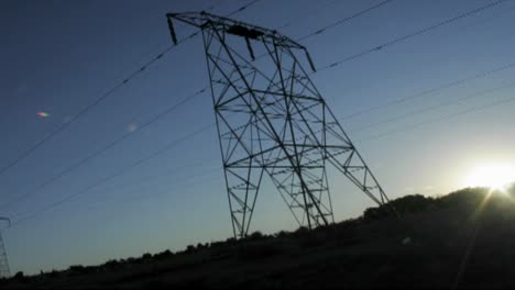 High-tension-lines-against-the-rising-sun
