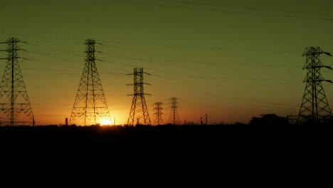 The-sun-sets-behind-high-tension-lines-in-this-time-lapse-shot