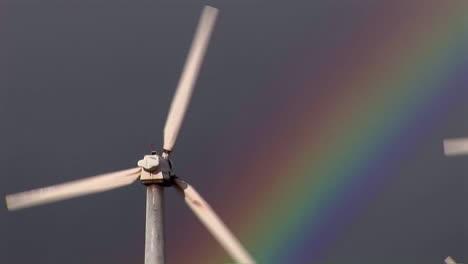 Gorgeous-rainbows-illuminate-wind-powered-generators-spinning-2