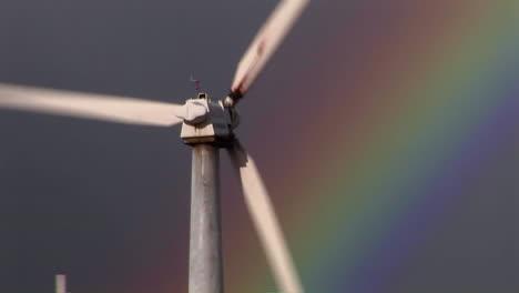 Tilt-up-to-gorgeous-rainbows-illuminate-wind-powered-generators-spinning