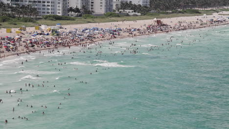 Wide-shot-Miami-Florida-extremely-crowded-baches-from-the-POV-from-a-cruise-ship