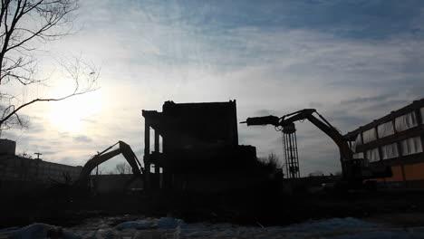 Un-Edificio-Es-Demolido-Y-Un-Avión-Sobrevuela