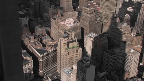 The-Empire-State-Building-s-shadow-falls-on-several-smaller-buildings-below