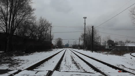 A-person-crosses-a-railway-line-on-a-bicycle
