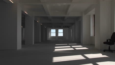 An-empty-building-from-inside-the-camera-zooms-towards-the-window