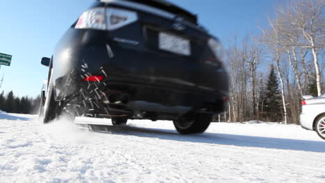 A-car-driving-on-a-snowcovered-road