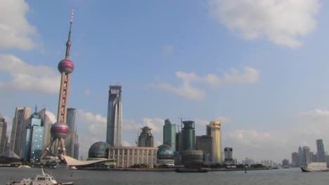 An-establishing-shot-of-Shanghai-China-with-the-Huangpu-River-in-foreground