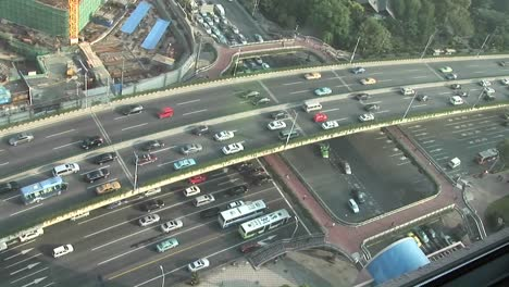 Overhead-picture-of-sped-up-traffic-on-an-overpass-in-Shanghai-China