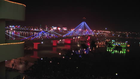 View-from-an-apartment-of-a-bridge-over-a-river-at-night