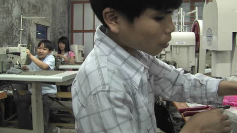 Asian-youths-sew-in-a-factory