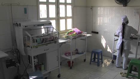 Nurse-taking-care-of-a-new-born-baby-in-birth-center-in-a-third-world-hospital-in-China