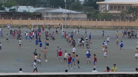 Boys-in-a-school-yard-playing-soccer