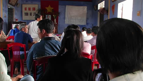 A-woman-addresses-a-group-of-people-in-a-classroom-in-Vietnam-