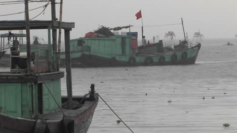 A-ship-along-with-other-two-ships-are-standing-aside-in-the-sea-shore-in-Vietnam