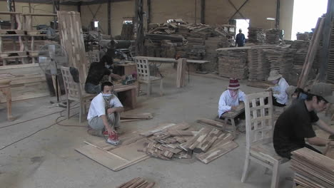 Wood-workers-hard-at-work-crafting-hand-made-furniture