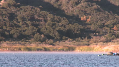 An-eight-person-rowing-sweep-being-followed-by-their-coach-on-Lake-Casitas-in-Oak-View-California