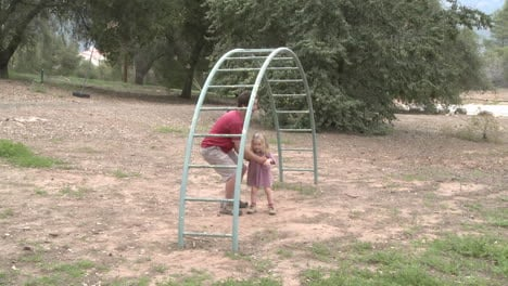 Time-lapse-of-a-father-and-daughter-playing-on-a-monkey-bars-in-Ojai-California