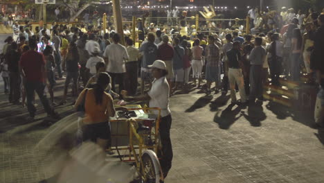 Panning-time-lapse-of-a-crowd-at-a-boxing-event-in-Zihuatanejo-Mexico