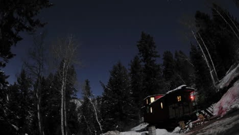 Time-lapse-of-night-sky-above-a-train-caboose-at-Strawberry-Hot-Springs-Colorado