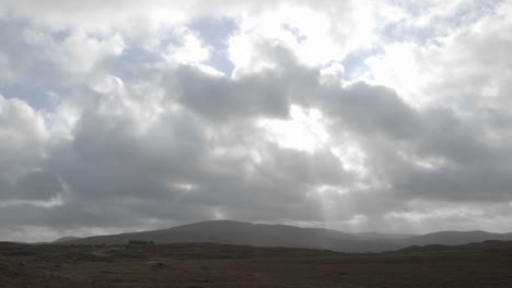 Time-lapse-of-clouds-and-sun-flares-over-peat-bogs-at-Croagleheen-Ireland