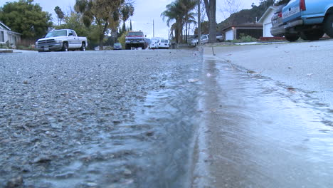 Water-running-off-the-sidewalk-after-a-rain-in-Oak-View-California