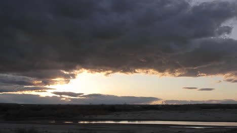 Zoom-out-time-lapse-of-clouds-and-sunset-at-Homolovi-Ruins-State-Park-near-Winslow-Arizona