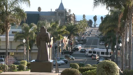 Side-view-of-cars-driving-in-downtown-Ventura-California