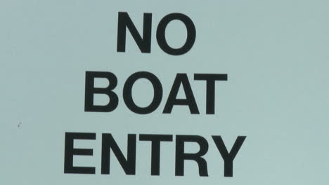 Tilt-down-on-No-Boat-Entry-sign-due-to-quagga-mussel-quarantine-at-Lake-Casitas-Recreation-Area-in-Oak-View-California