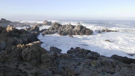 Wide-panning-time-lapse-of-waves-breaking-on-the-rocks-at-Point-Pinos-in-Pacific-Grove-California