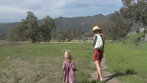 A-woman-and-girl-walking-through-a-restored-wetlands-at-the-Ojai-Meadow-Preserve-in-Ojai-California
