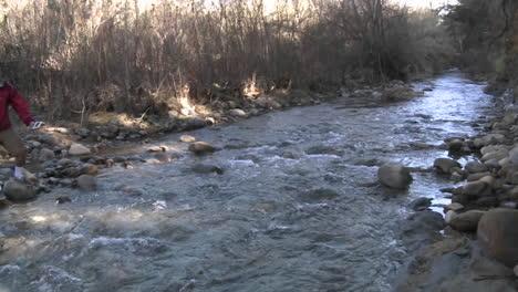 Pan-of-people-testing-the-water-flowing-in-San-Antonio-Creek-in-Ojai-California