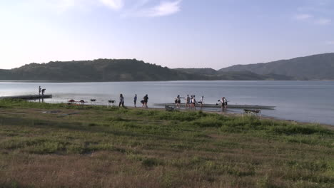 Time-lapse-of-eight-person-rowing-sweep-entering-the-water-on-Lake-Casitas-in-Oak-View-California