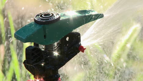 Close-up-of-sprinkler-spraying-water-in-Oak-View-California