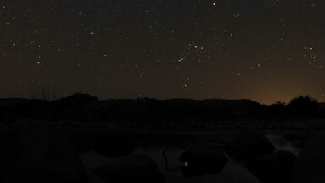 Time-lapse-of-the-moonrise-and-stars-setting-over-the-Ventura-River-in-Oak-View-California