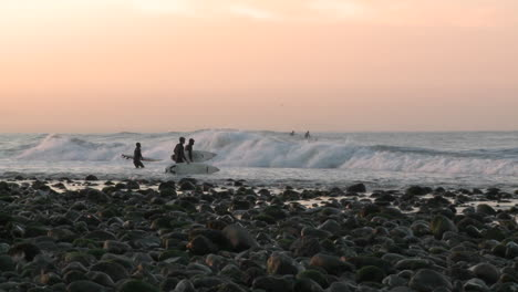 Surfers-paddling-out-at-into-the-waves-at-Surfers-Point-in-Ventura-California