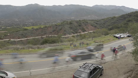 Peloton-in-slow-motion-during-a-time-lapse-of-the-2008-Tour-of-California-bike-race-passing-over-Dennison-Grade-in-Ojai-California