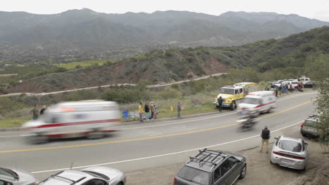 Peloton-passing-in-a-time-lapse-of-the-2008-Tour-of-California-bike-race-passing-over-Dennison-Grade-in-Ojai-California