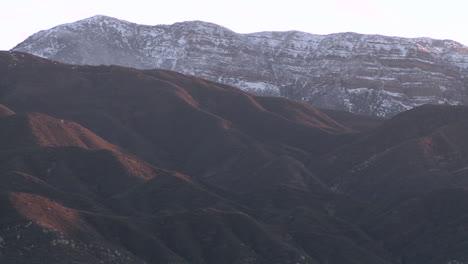 Closeup-pan-of-the-snow-covered-Topa-Topa-Mountain-above-Ojai-California