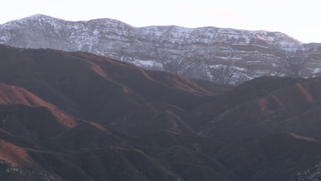 Zoom-out-of-the-snow-covered-Topa-Topa-Mountain-above-Ojai-California