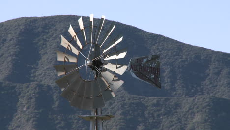 Spinning-windmill-drawing-water-from-a-well-in-Ojai-California