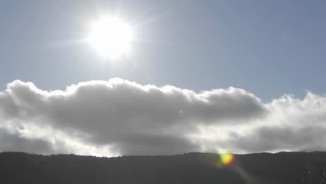 Time-lapse-of-spring-clouds-passing-over-a-ridge-in-Oak-View-California