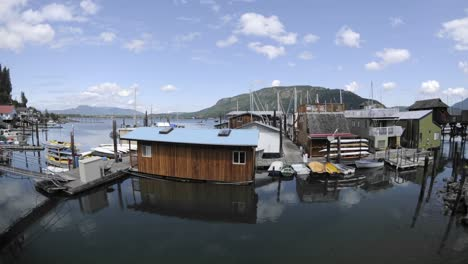 Time-lapse-of-clouds-passing-over-a-dock-and-boats-in-Cowichan-Bay-on-Vancouver-Island-in-British-Columbia-Canada