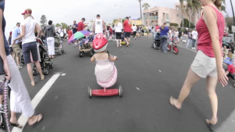 Point-of-view-time-lapse-of-a-girl-on-a-tricycle-in-the-Fourth-of-July-Parade-in-Ventura-California