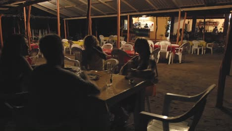 Time-lapse-of-people-dining-outdoors-at-La-Saladita-Beach-in-Guerrero-Mexico
