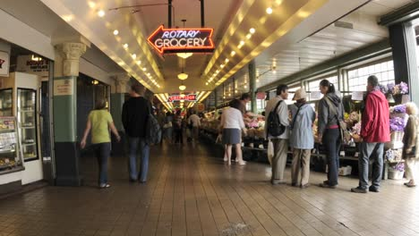 Zoom-out-time-lapse-of-people-walking-at-Pike-Place-Market-in-downtown-Seattle-Washington