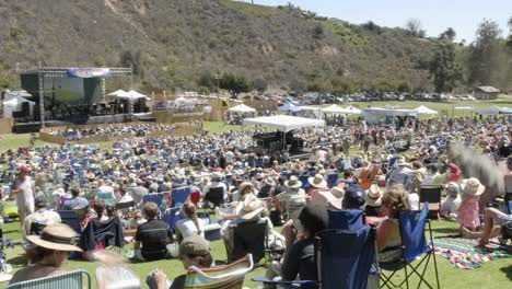 Zoom-out-time-lapse-of-a-crowd-at-an-outdoor-concert-in-Ventura-California