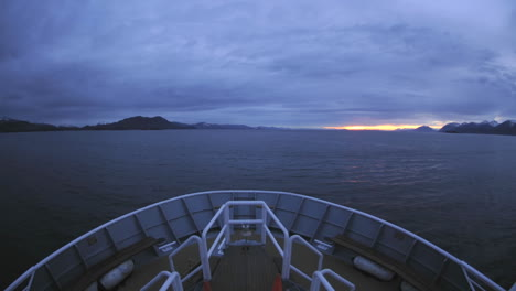 Point-of-view-time-lapse-of-a-ship-cruising-up-Chatham-Strait-at-dusk-in-Southeast-Alaska
